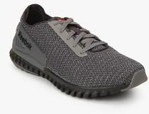 305a4873355daa Reebok Twistform 3.0 Grey Running Shoes for Men online in India at ...